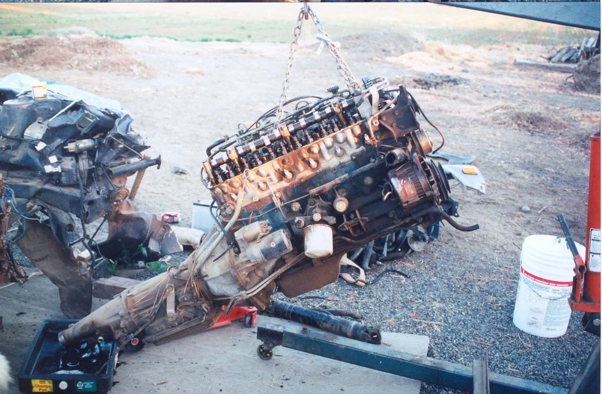 Datsun/Nissan 280zx Turbo Engine Swap on 280z ignition system, 280z light wiring, 280z gauges, 280z fuel filter, 280z timing chain, 280z water temp sensor, 280z engine swap, 280z throttle position sensor, 280z power steering, 280z brake light switch, 280z starter relay, 280z throttle cable, 280z oil pan, 280z dash removal, 280z front strut bar, 280z transmission swap, 280z transmission parts, 280z alternator wiring, 280z half shafts, 280z ignition wiring,